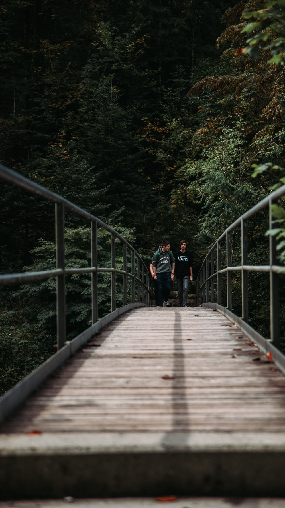 two people walking in bridge