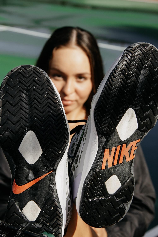 pair of black Nike soles