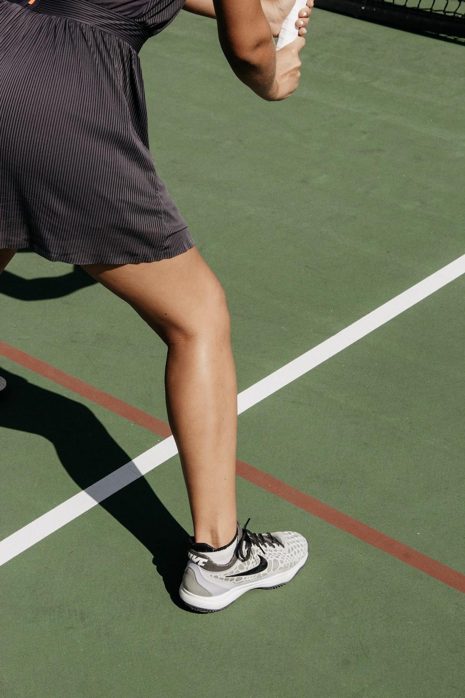 person wearing gray Nike low-top sneaker
