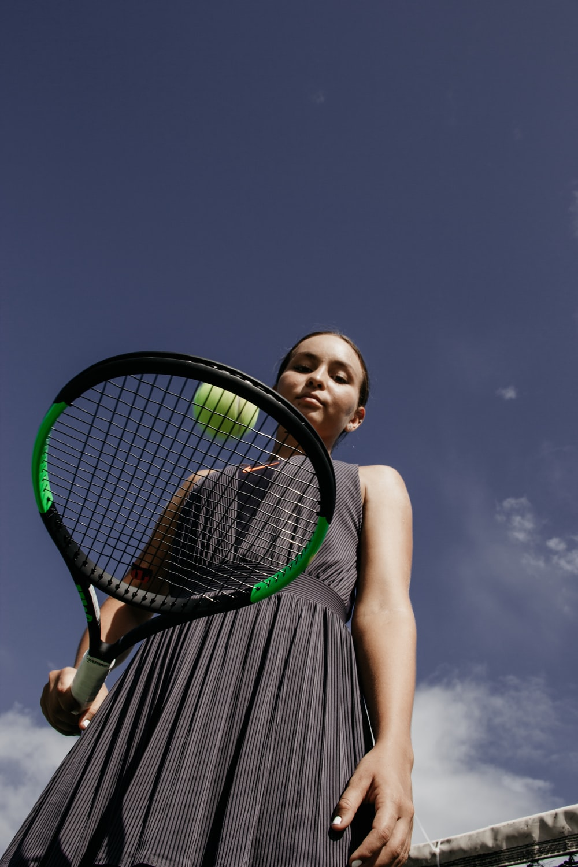 woman holding tennis racket