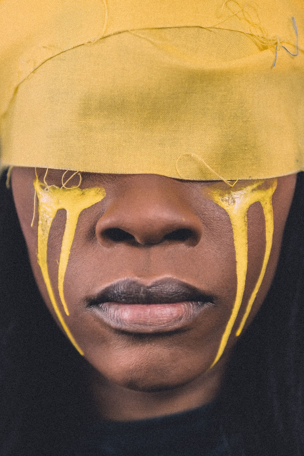 woman' face with yellow paint