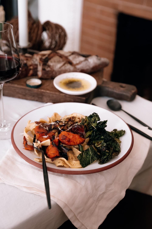 cooked pasta on round white ceramic plate