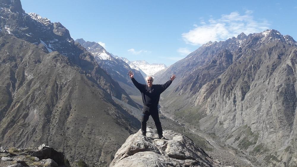 man standing on white rock