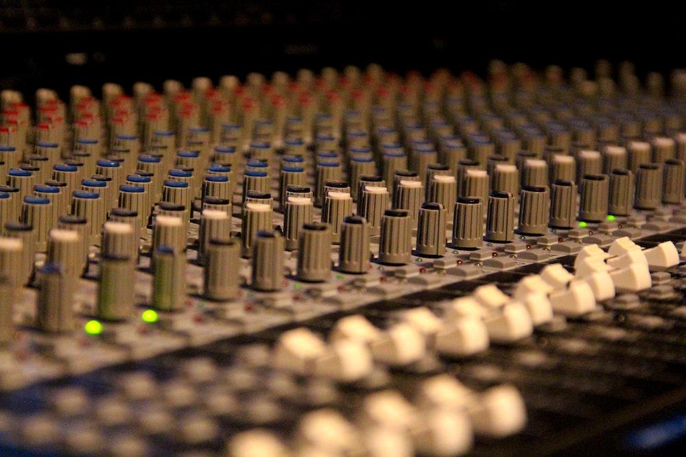 selective focus photo of audio mixer
