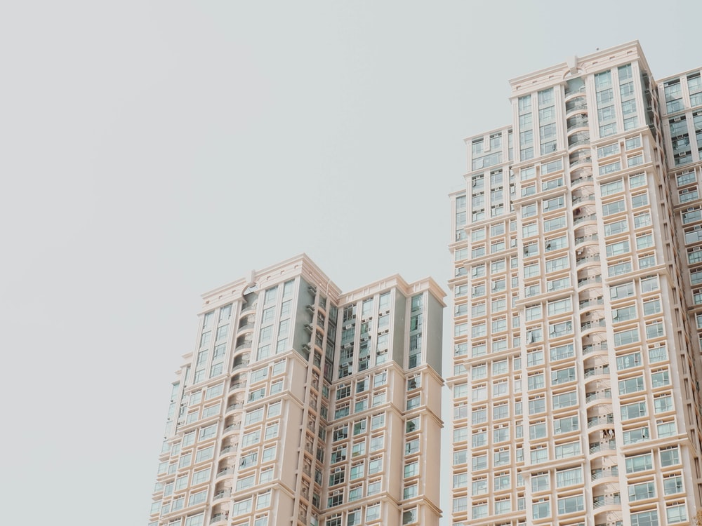 low-angle photography of white high-rise buildings