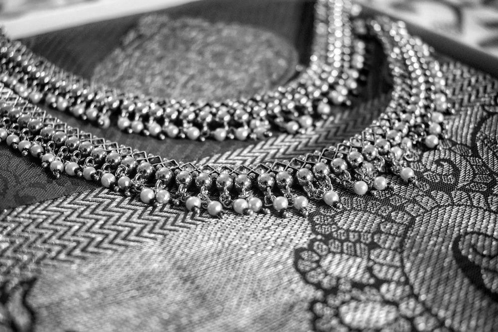gray beaded garment