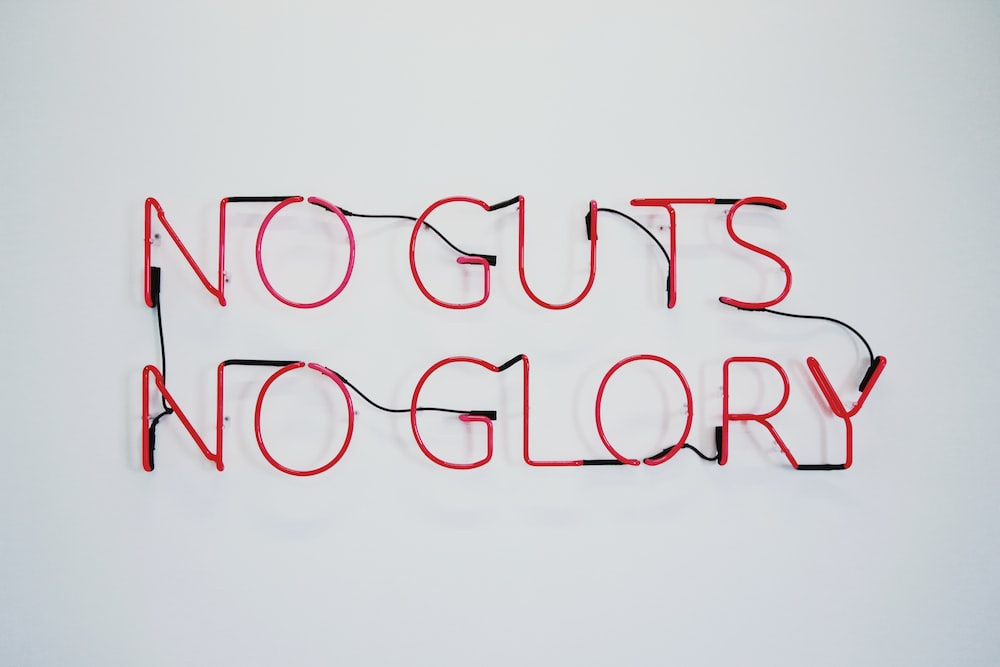 red no guts no glory neon signage