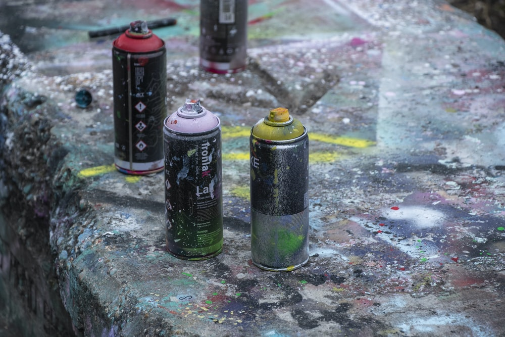 four black paint sprayers\