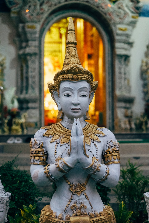 Buddha statue near building
