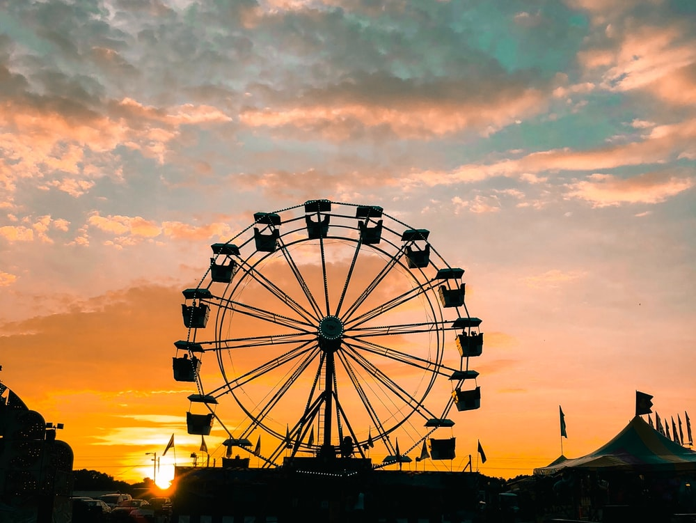 silhouette of fferrsi wheel during golden hour