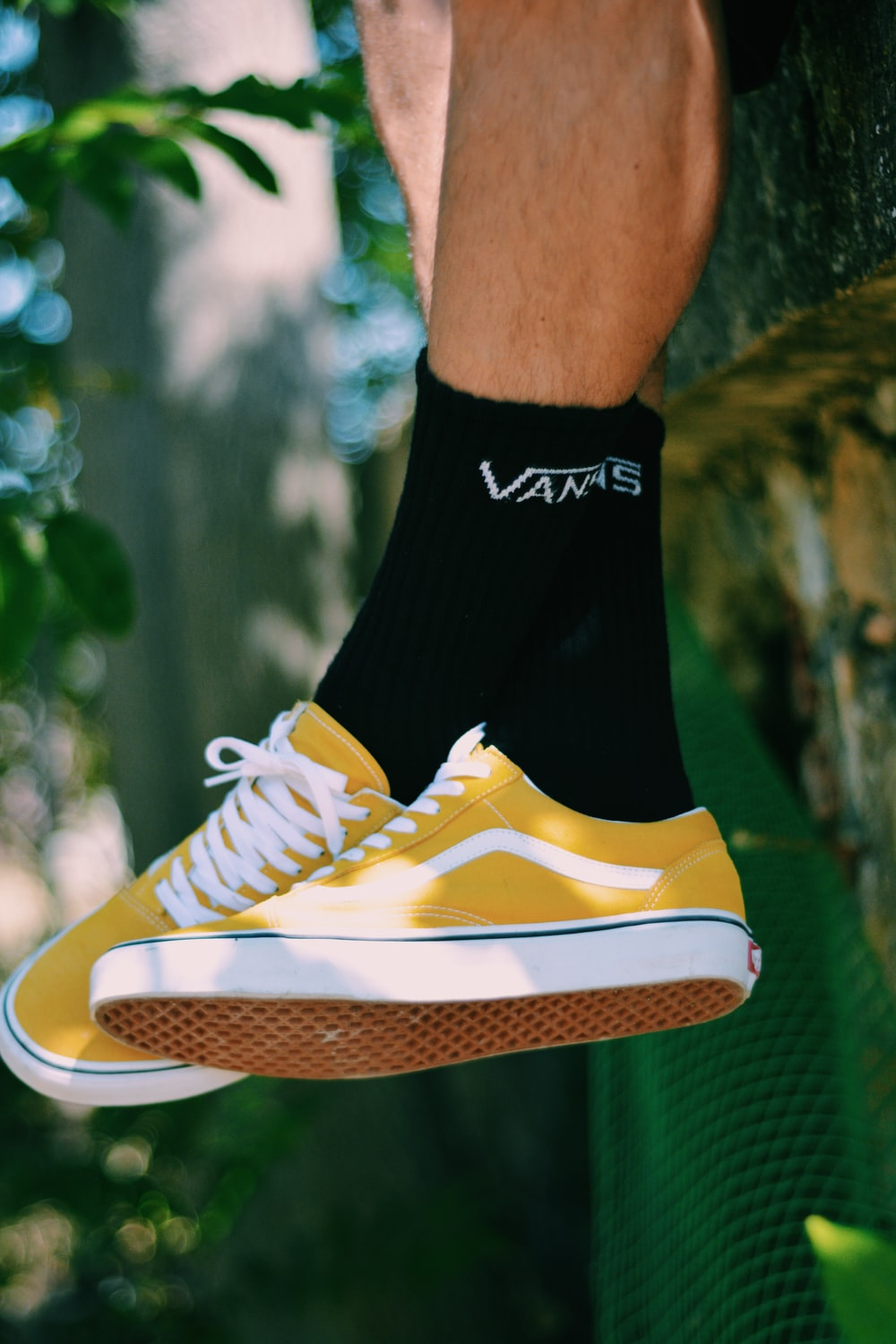 pair of yellow-and-white Vans low-top shoes