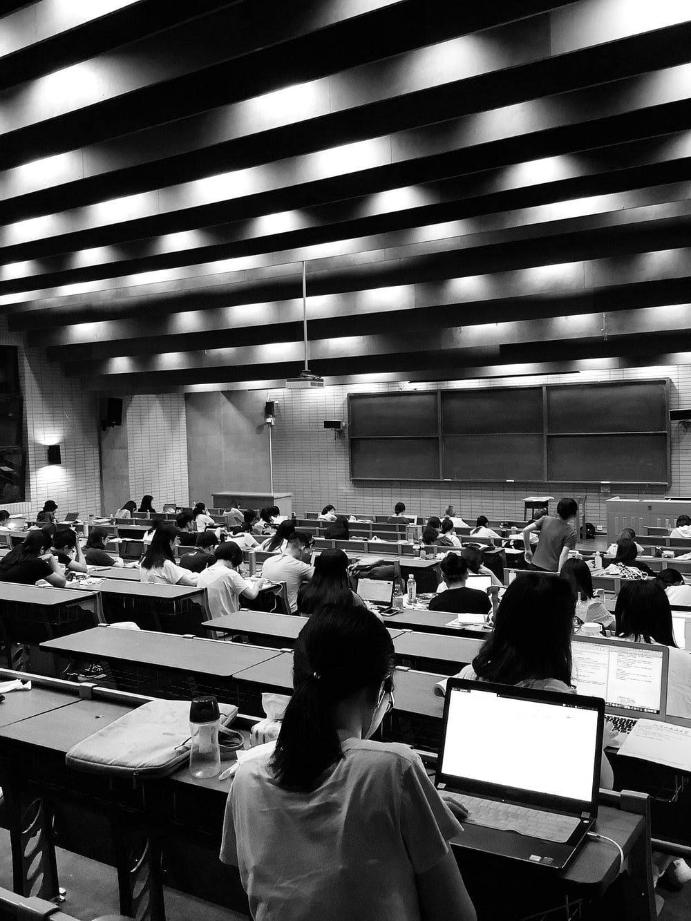 graysacale photo of students in room
