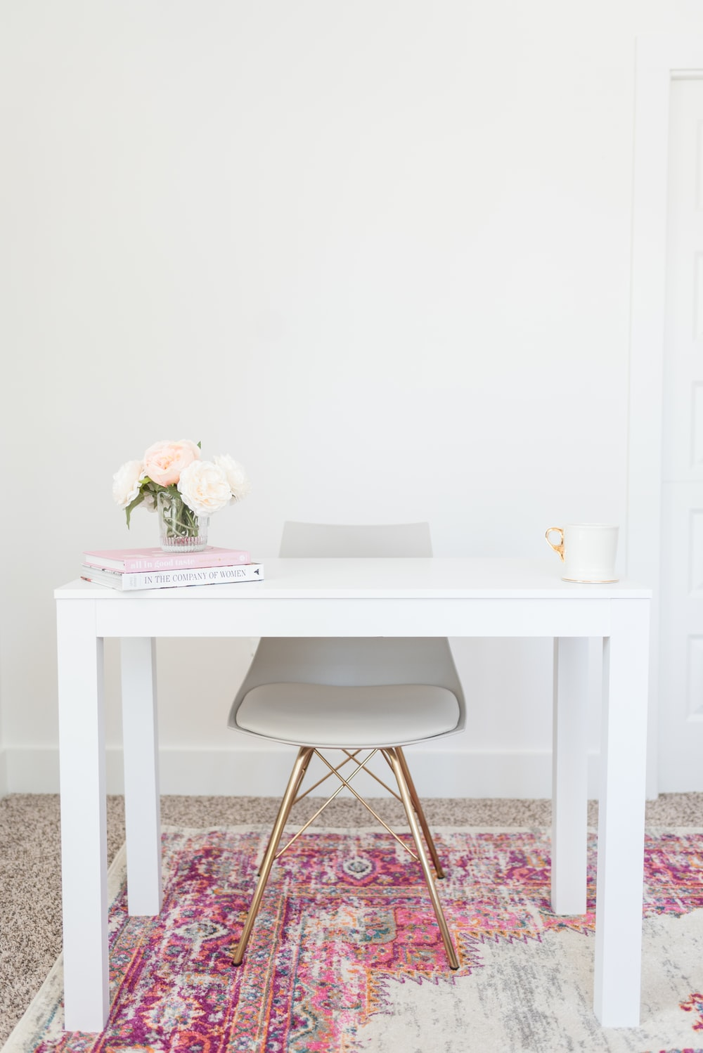 white table and chair minimalist photo