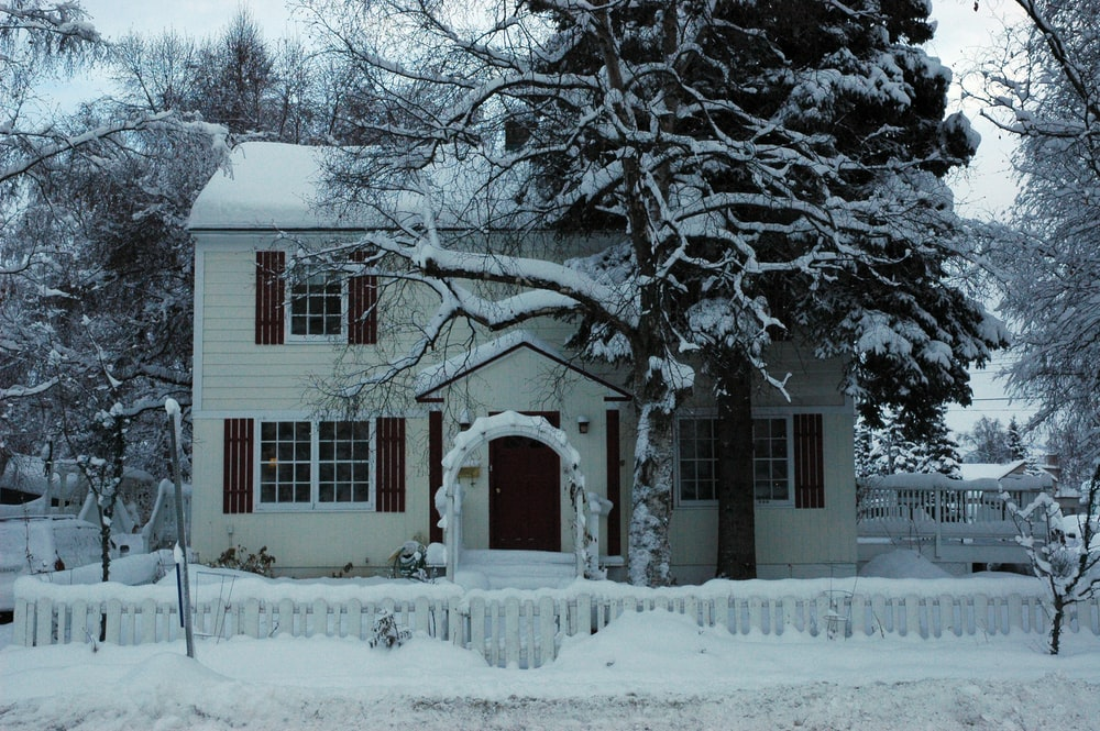 duplex house covered with snow