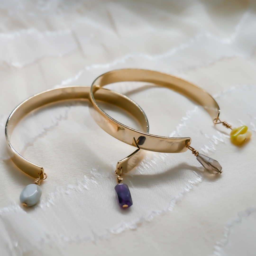 Jewelry: Gold bangles with gemstones from SEASHELL IN LOVE