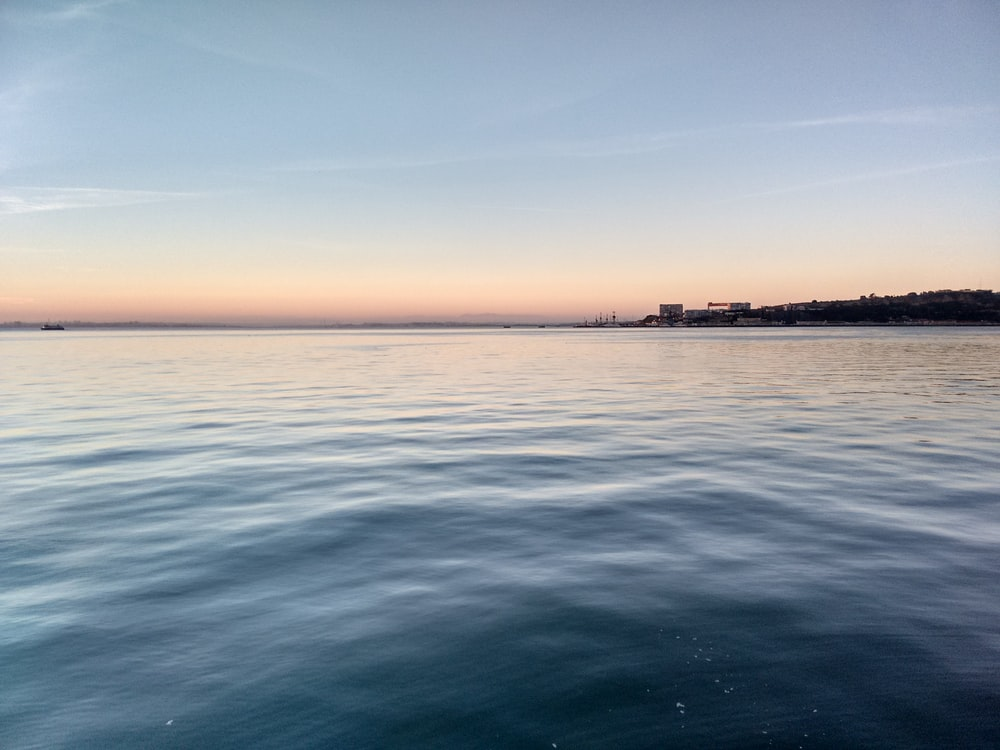 body of water during daytime photo