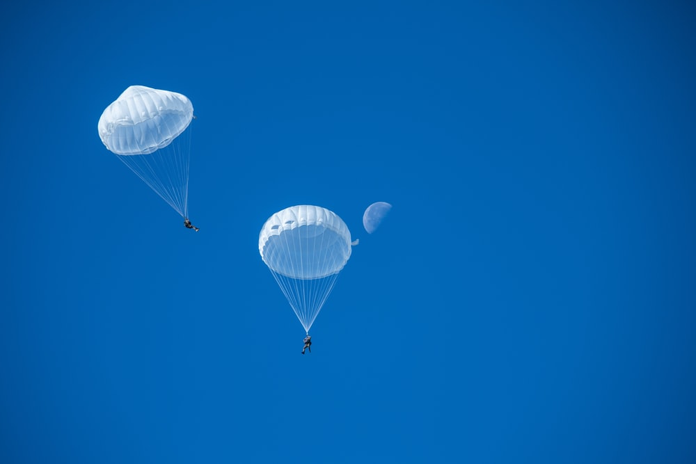 two white parachutes