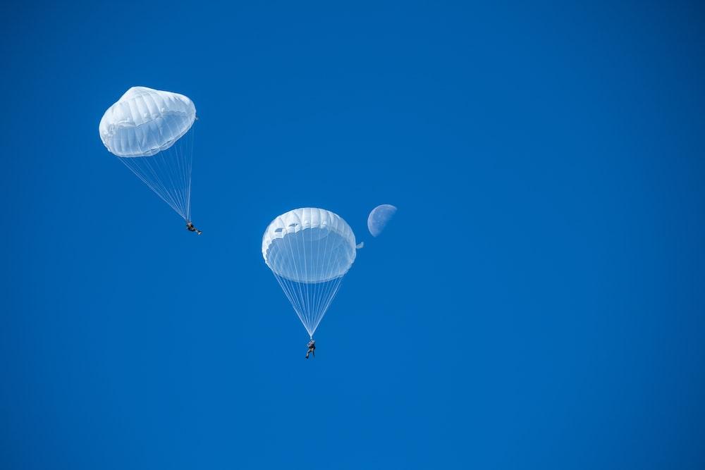 two white parachutes