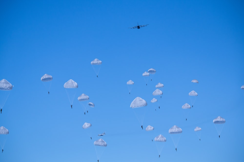 white parachutes during daytime photo