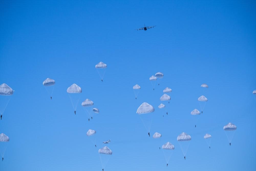 white parachutes during daytime photo