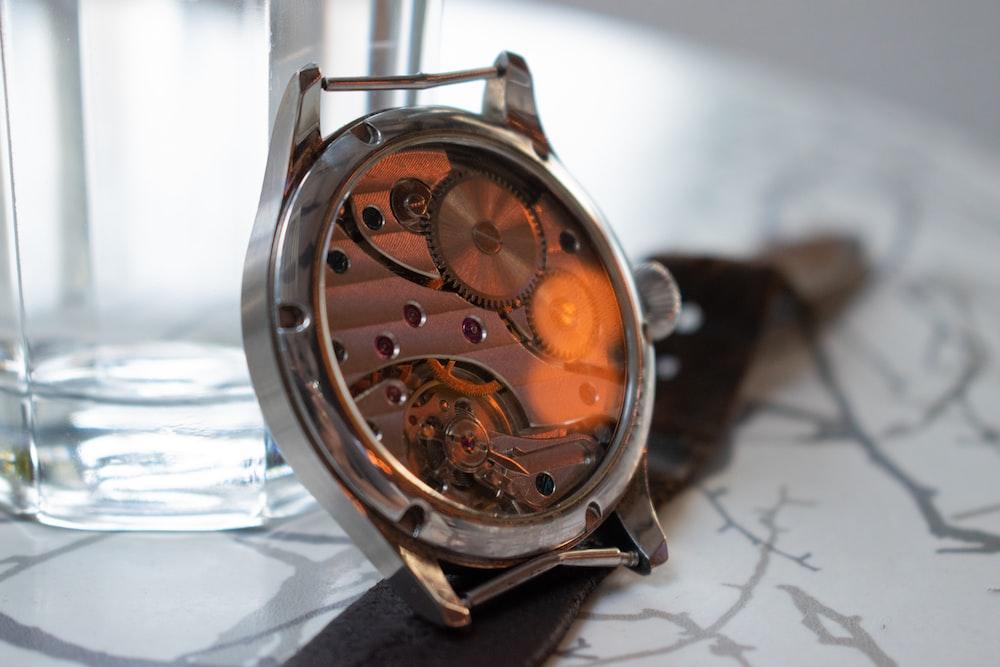 round brown skeleton watch
