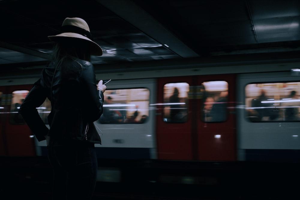 woman wears brown hat