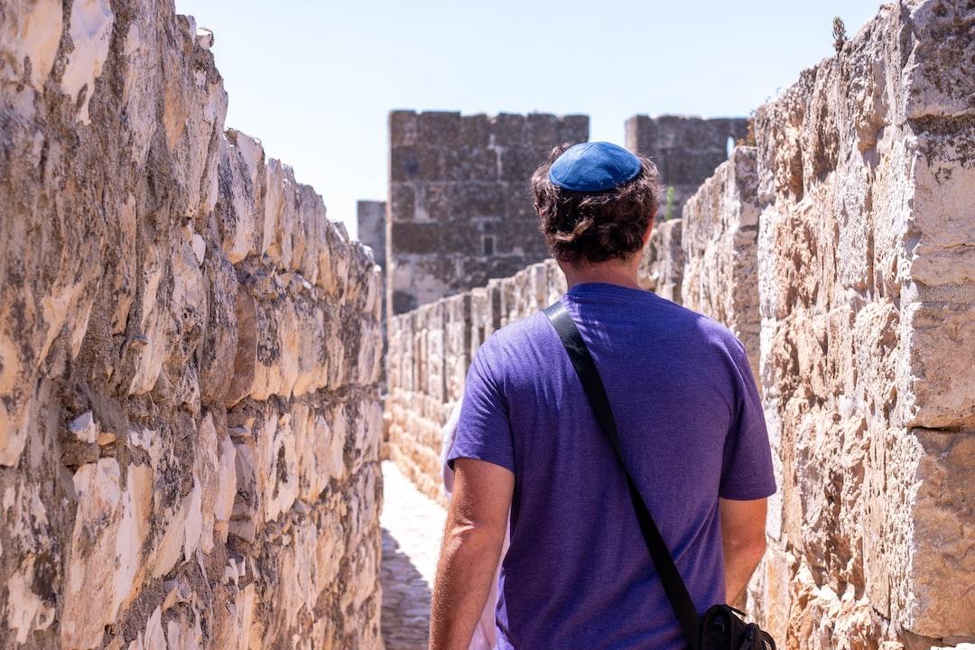 Jewish Man Walking along The Old City Of Jerusalem