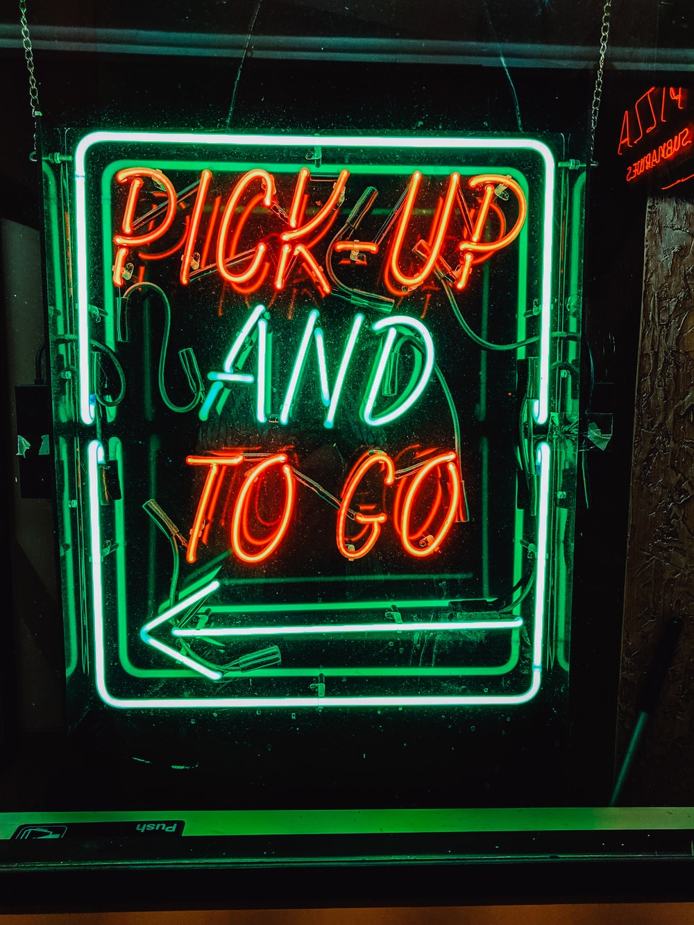 orange and green pick-up and to go neon signage