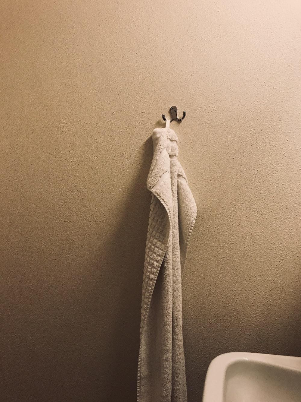 hung white towel