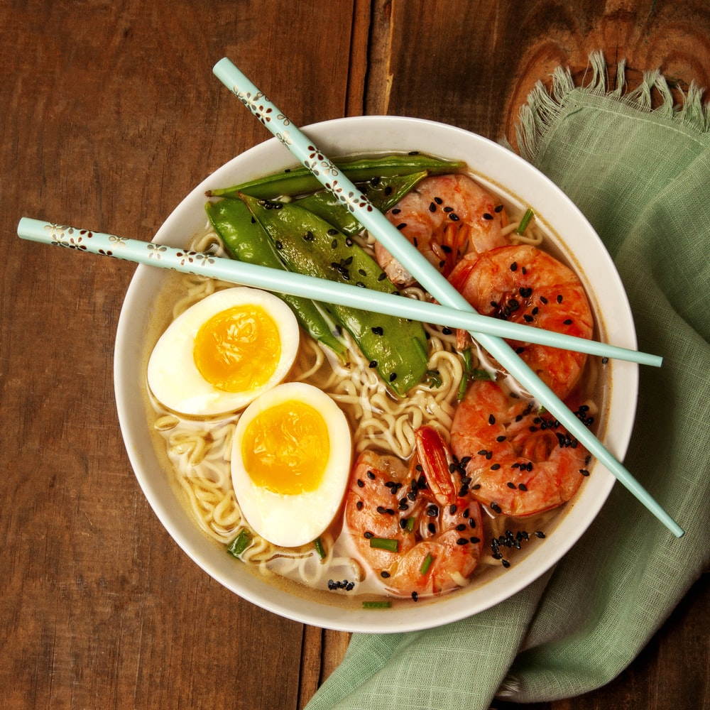 round white bowl with ramen and egg