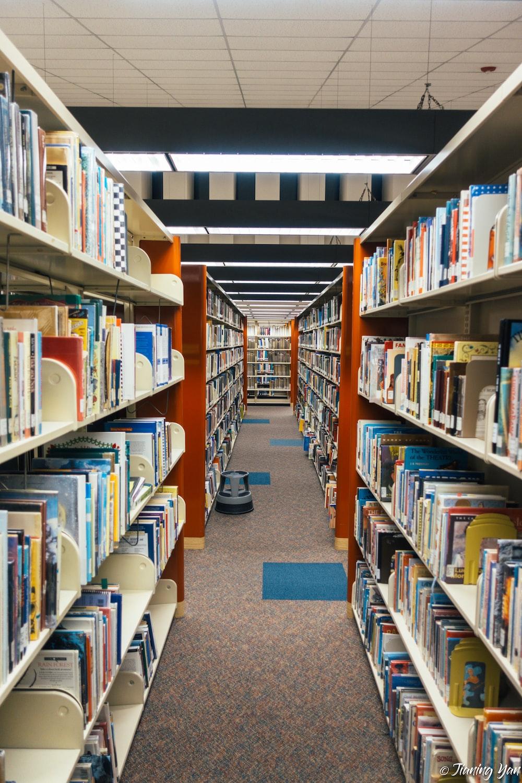 pile of assorted books on shelf