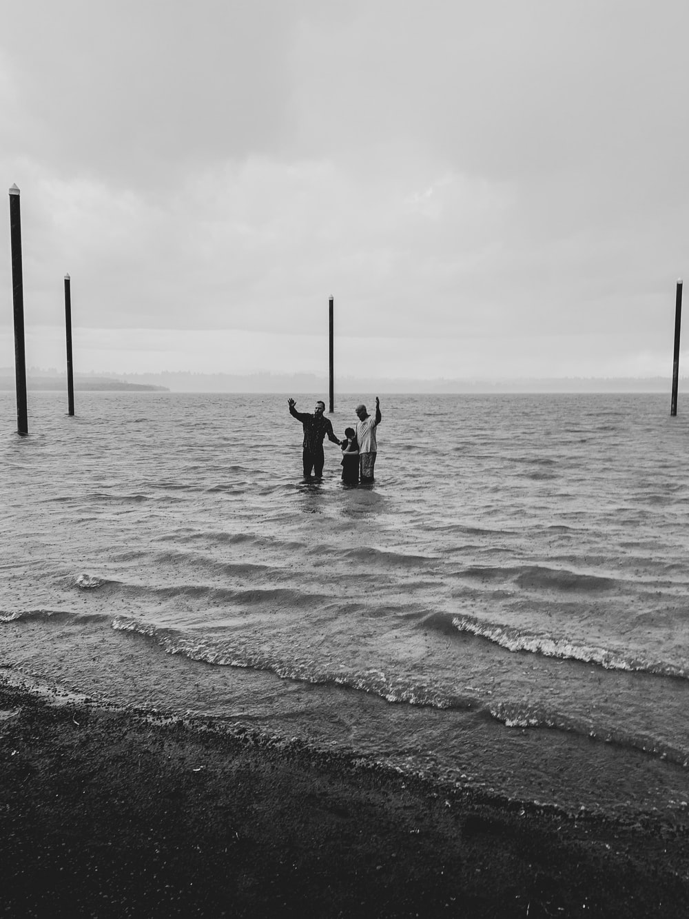 three person on sea
