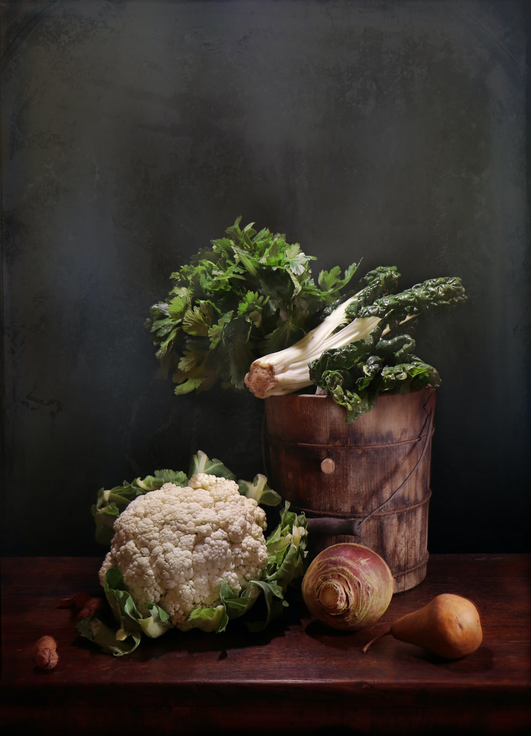 still life with cauliflower, silverbeet, celery, swede and pear.