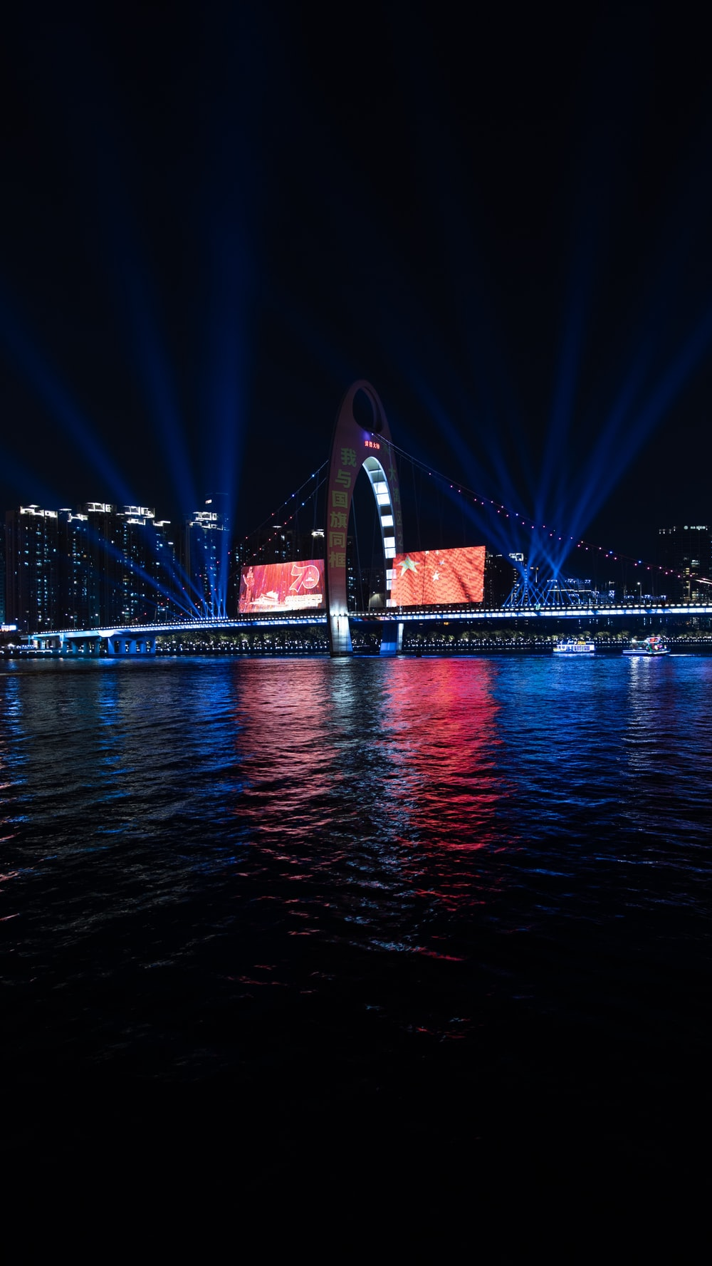 stage lights reflection on body of water at night