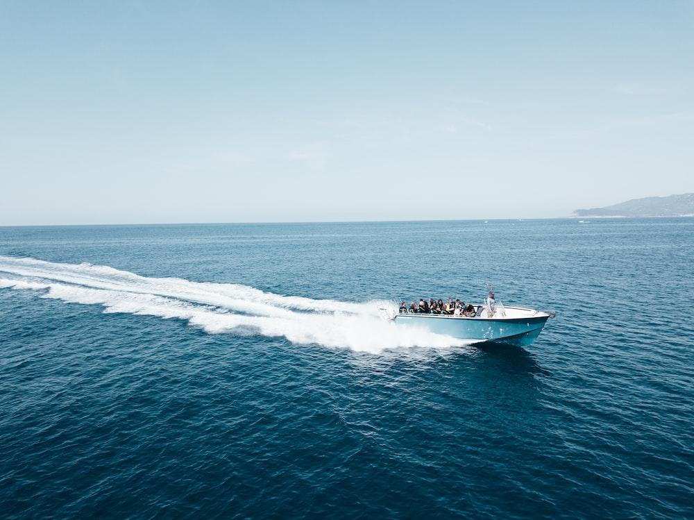 white speedboat on body of water during daytime