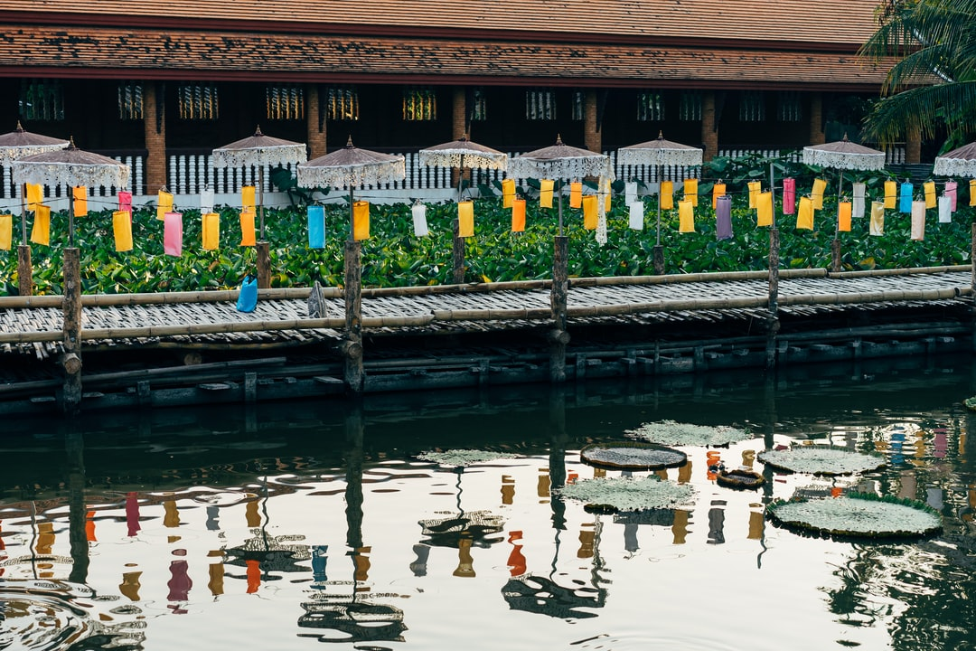 Temple with a lake and umbrellas in Chiang Mai, Thailand