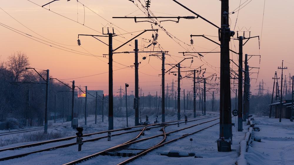 black railroad on focus photography