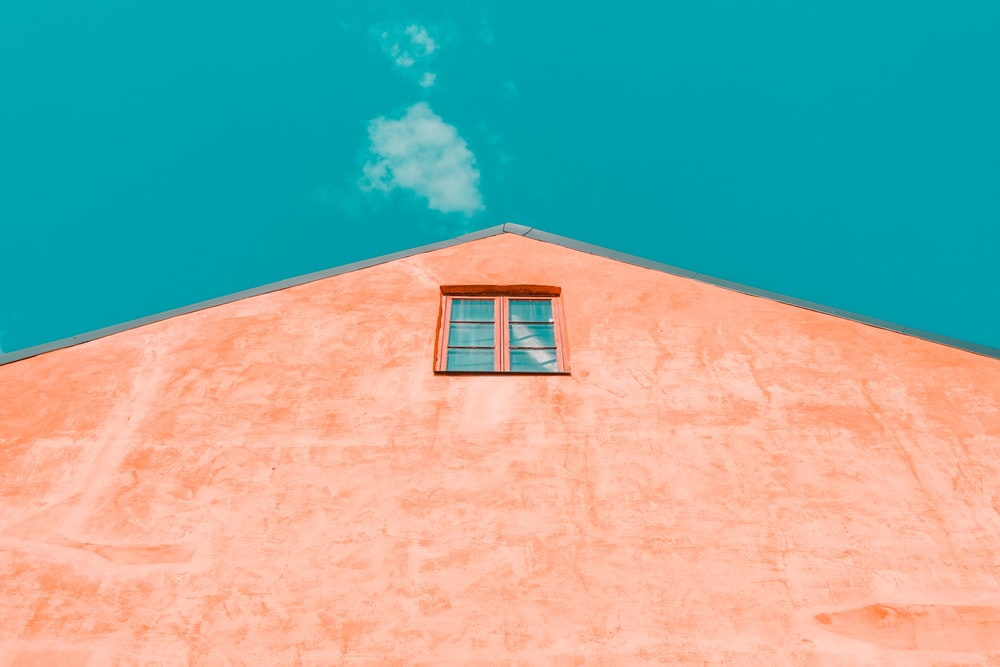 brown building under blue sky