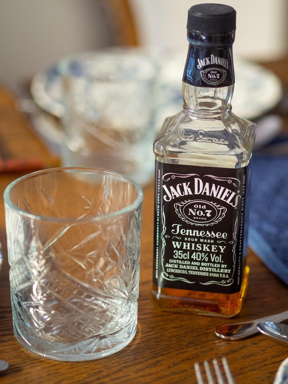 empty cup beside Jack Daniel's bottle