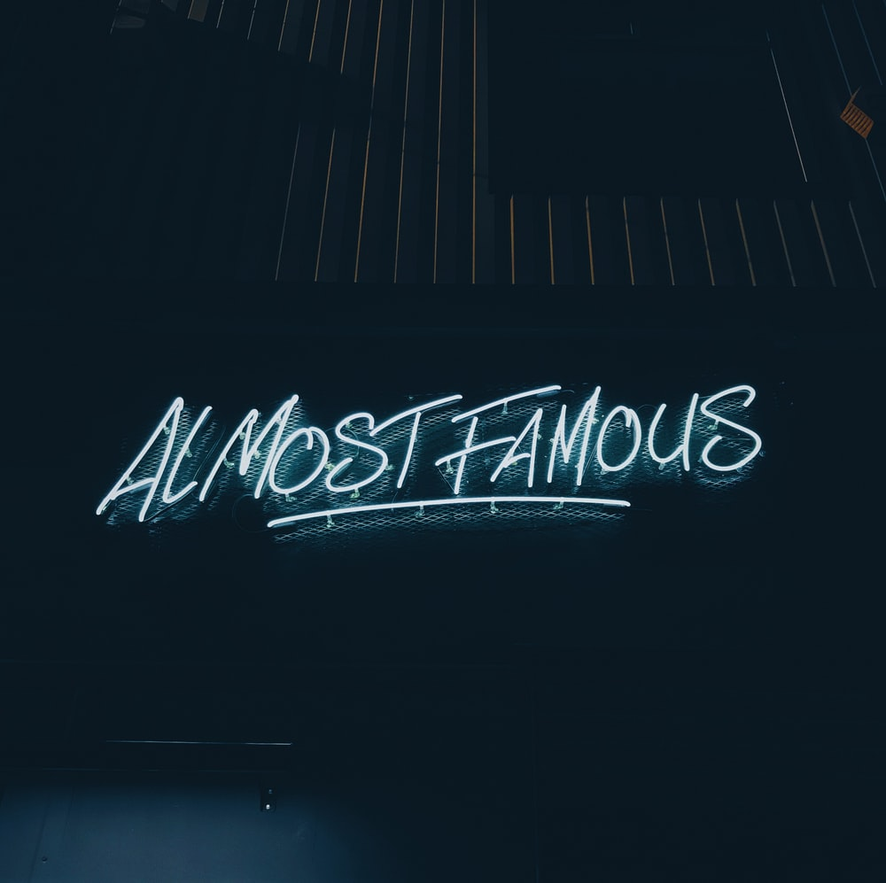 white almost famous neon signage