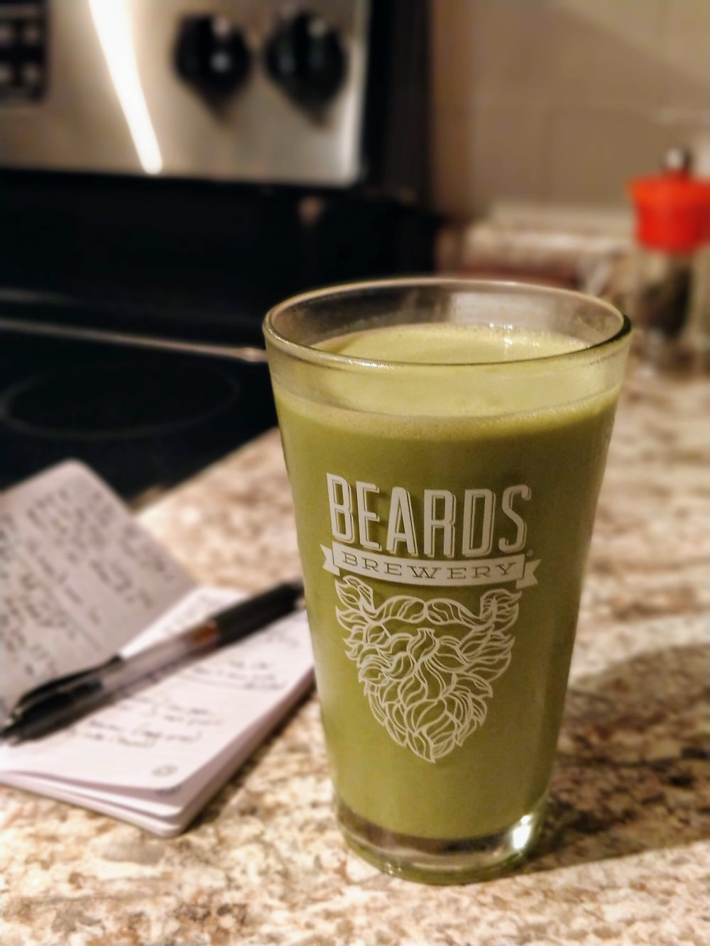 Beards Brewery-printed drinking glass with green liquid