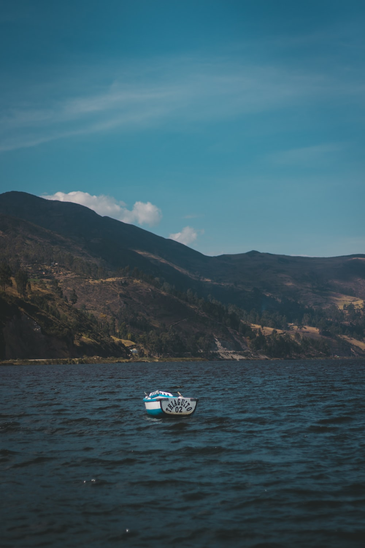 white row boat on lake