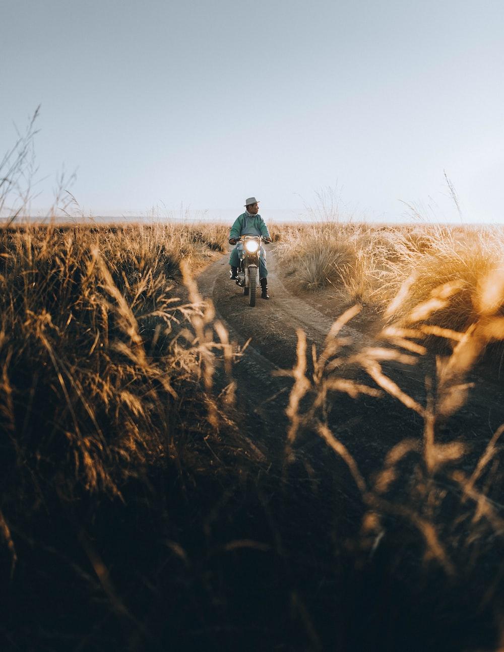 man riding motorcycle during day