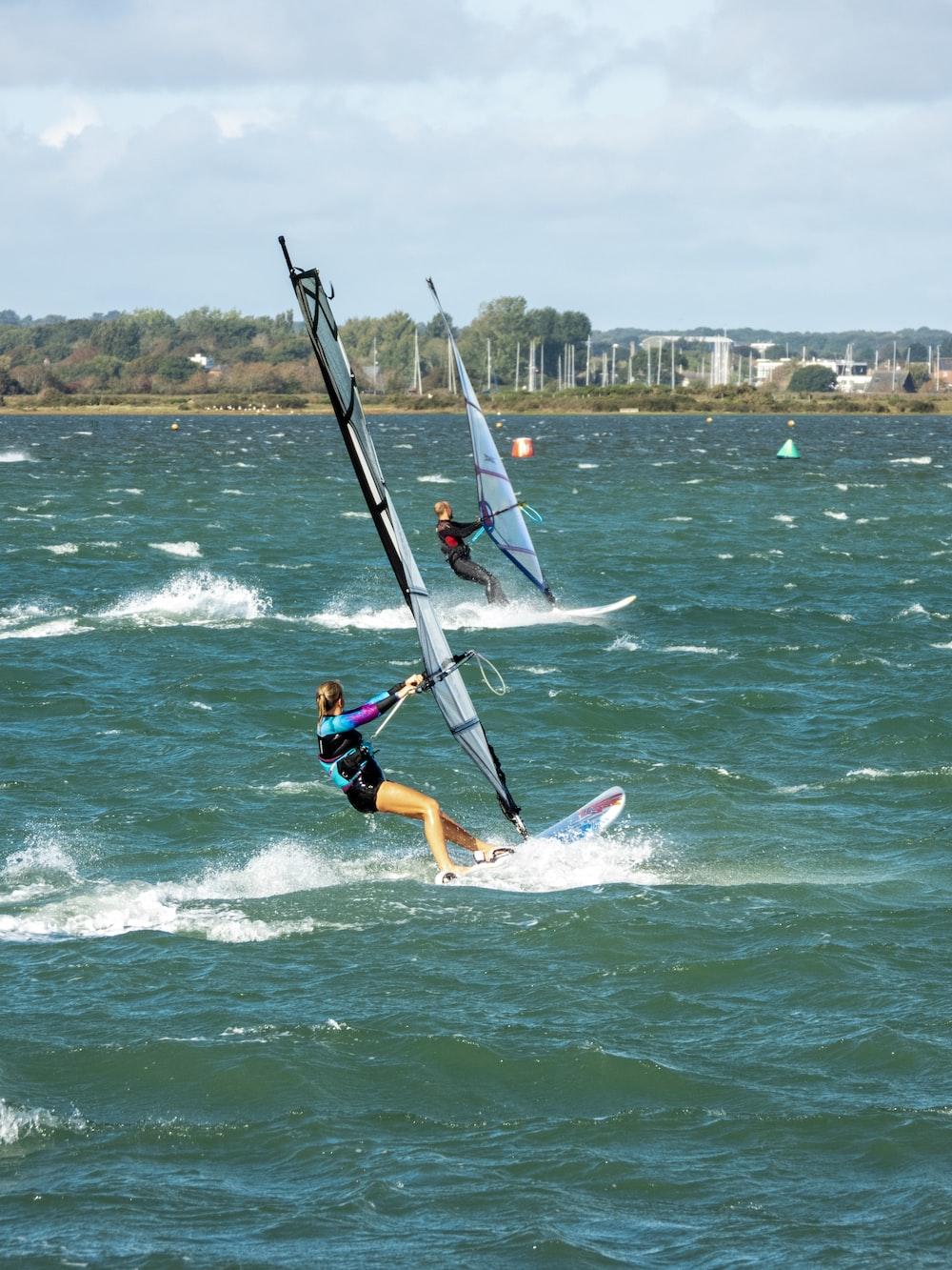 woman sailing surfboard