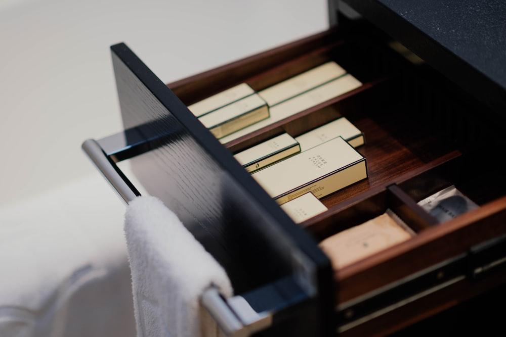 boxes inside black wooden drawer