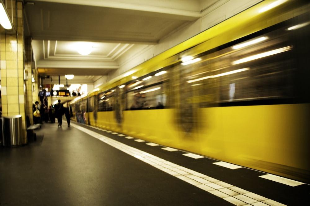 people walking beside train