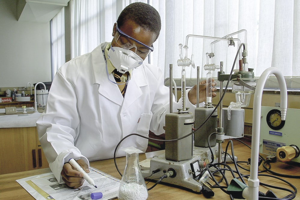 man inside laboratory experiments and write down the details
