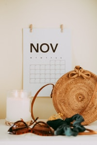 shallow focus photo of calendar mounted on white wall