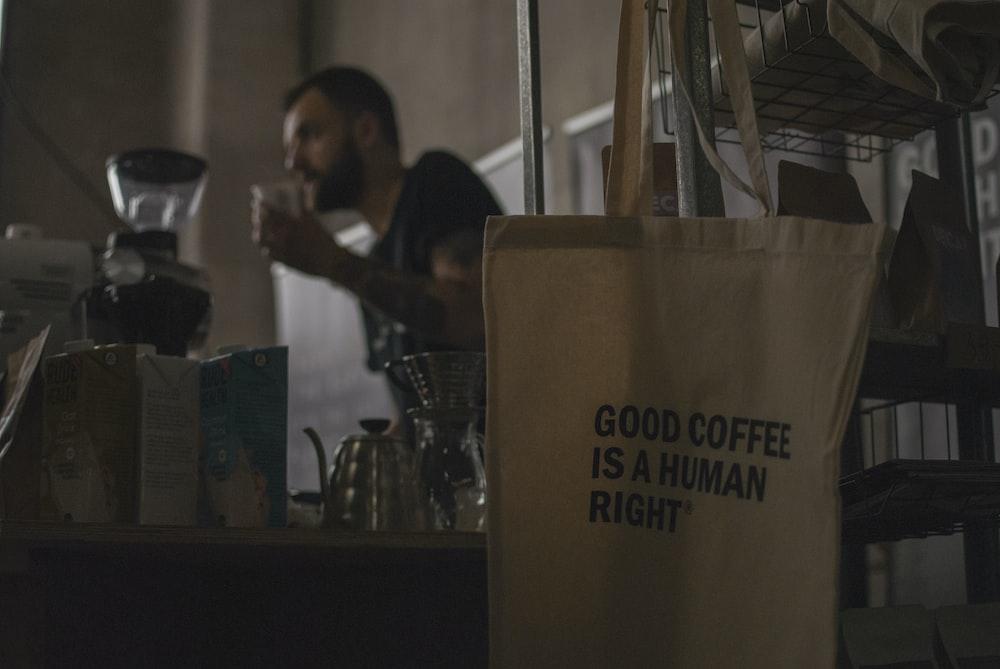 man standing front of coffeemaker
