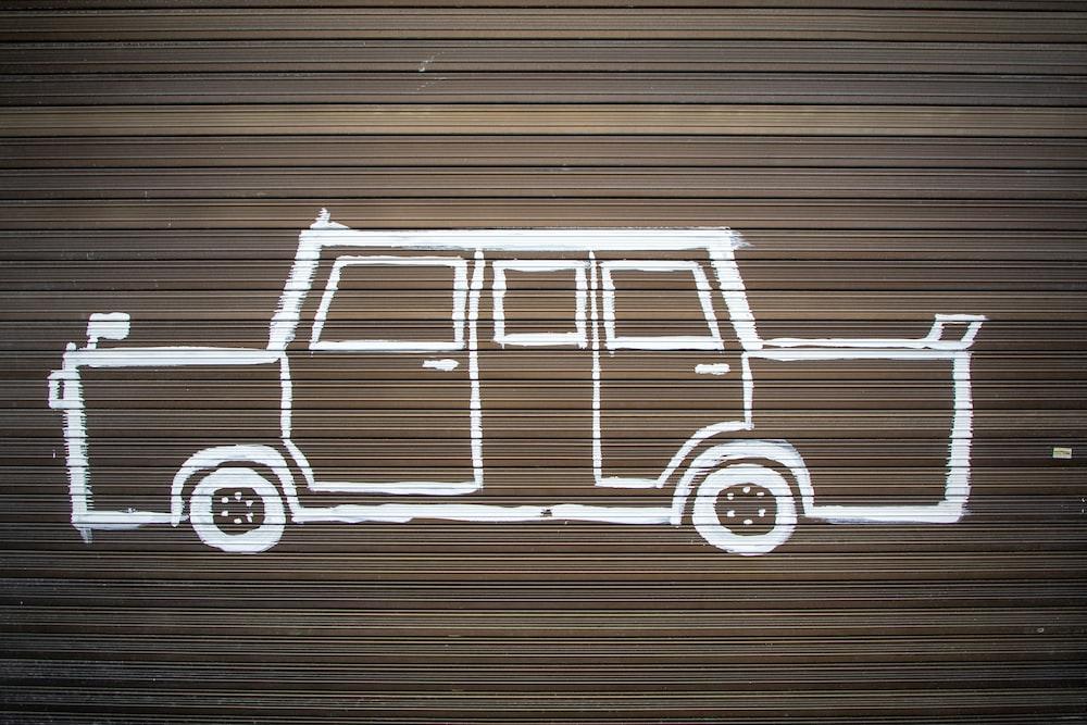 white sedan illustrated on gray wall